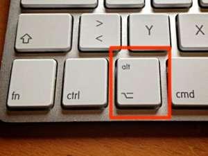 Die Wahltaste auf der Apple-Tastatur - (Foto: Martin Goldmann)